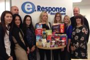 Some of the eResponse team with the start of their Foodbank collection.