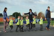 Bidford-on-Avon Church of England Primary School pupils have received hi-visibility vests from Taylor Wimpey. Children from the school with Alice Crothall, Taylor Wimpey sales executive Lynn Lowe and Andy Johnston.