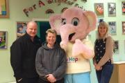 CitySigns joint partners Darren and Deanne Wilkins with New Hope mascot Emily the Elephant and founder Jean Wilson