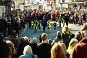Crowds watch nursery children run their race during Alcester's annual Pancake Day celebrations.