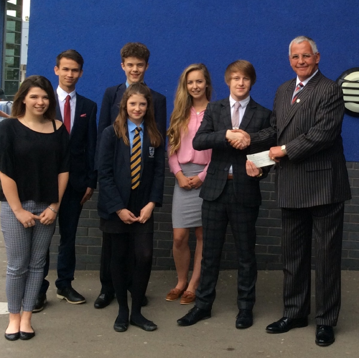 Pershore High School head boy Xavier Mytton and fellow pupils present a cheque to Worcestershire county coordinator for Help for Heroes Ian Baldry.