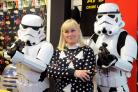 The force is with Admit One's owner Gail Beck as she poses with Star Wars stormtroopers.