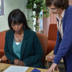 Redditch Advertiser: EastEnders snaps show Denise hovering over adoption forms