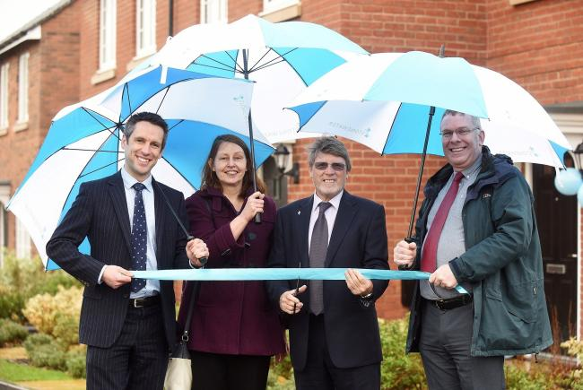 CUT THE RIBBON: From left: Jonathan Layzell, Stonewater executive director for development, Renata Mosz, Stratford on Avon District Council enabling officer; Colin Small, Stonewater board member and John Gordon, Stratford on Avon District Council enabling