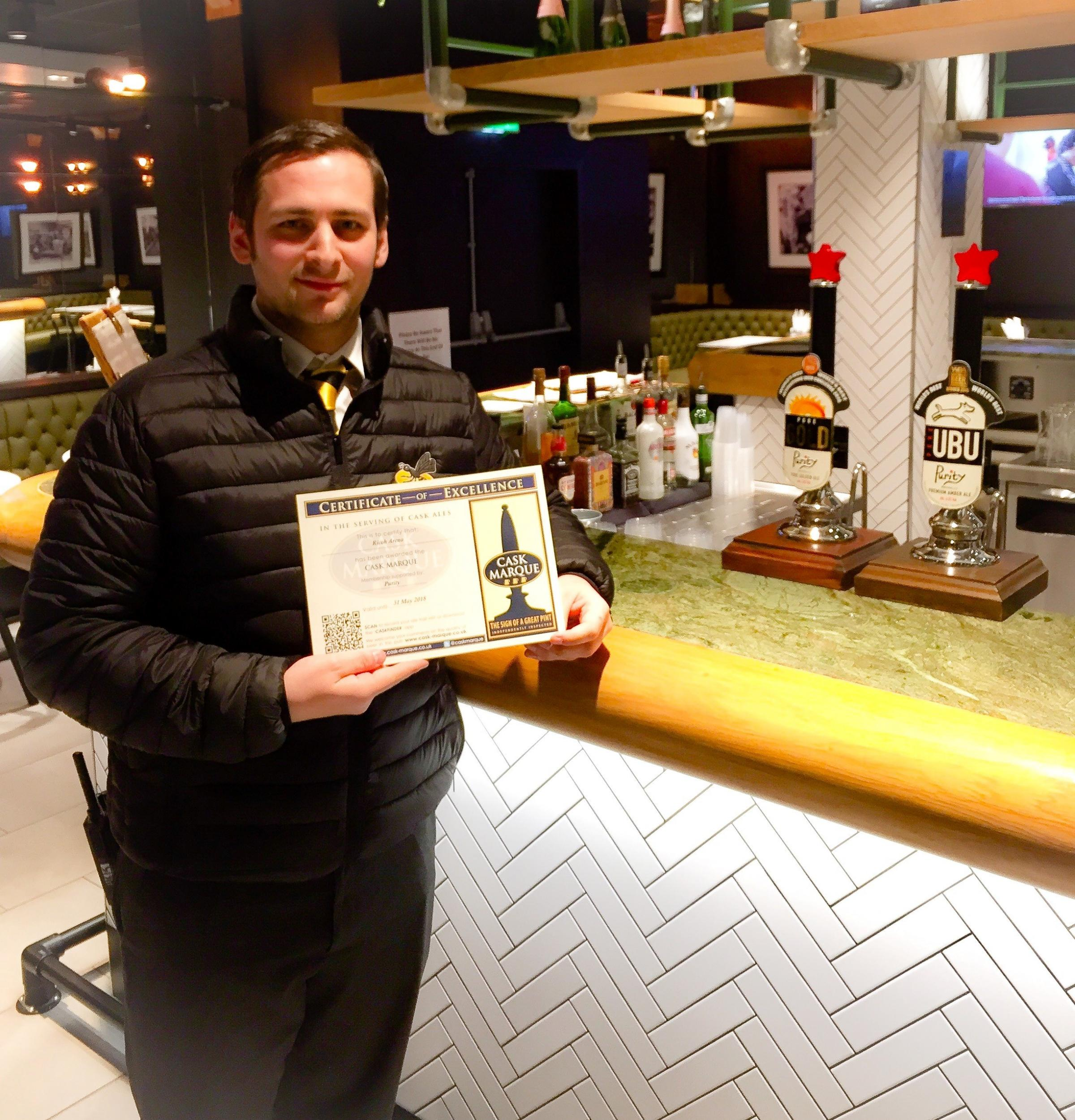 Ricoh Arena retail logistics manager with the  Cask Marque accreditation award.