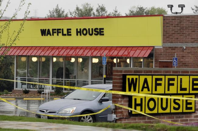 Police tape blocks off the Waffle House restaurant in Nashville, (Mark Humphrey/AP)