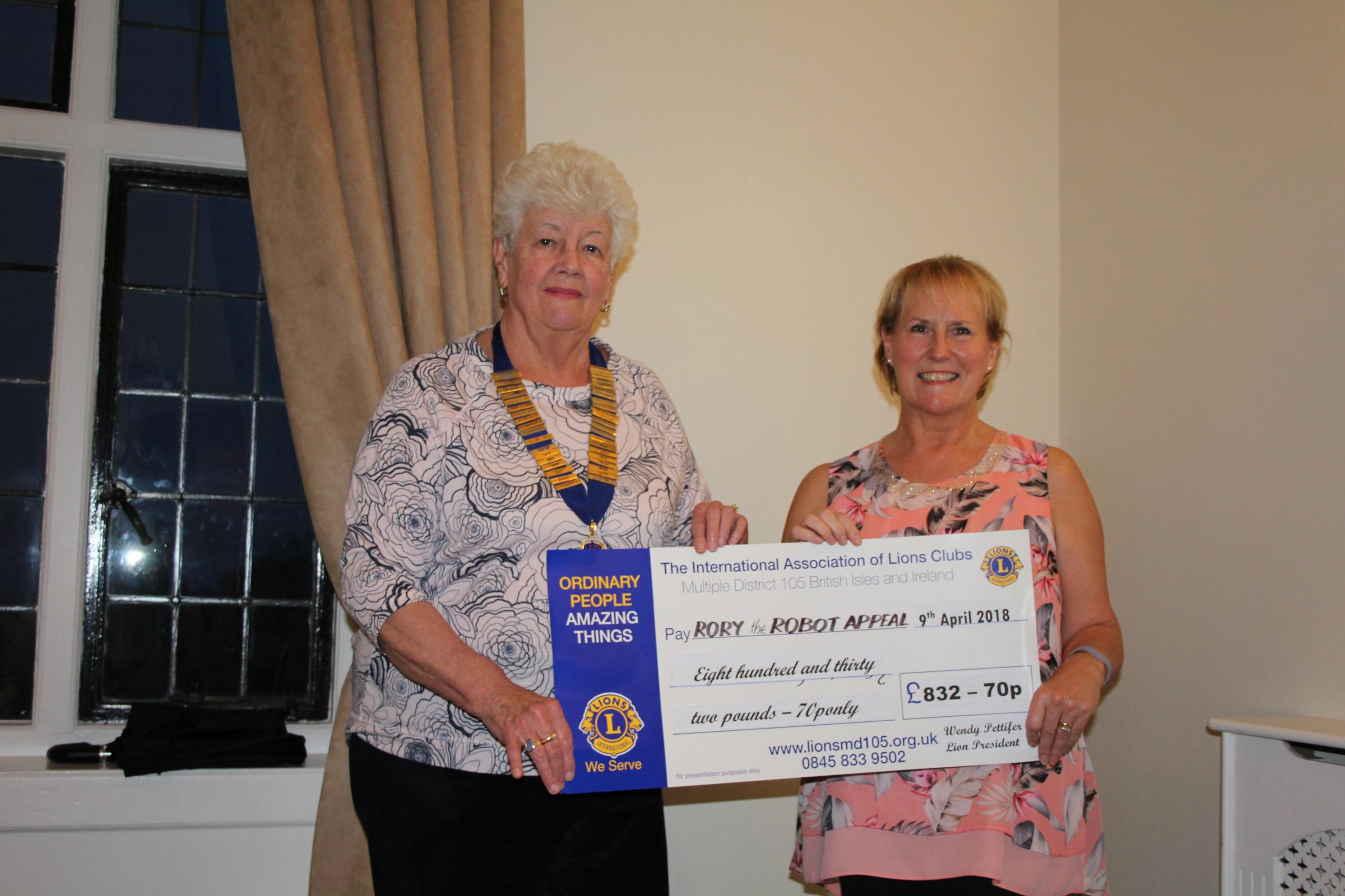 Lions President Wendy Pettifer presenting a cheque to Nicky Langford from the Rory the Robot appeal