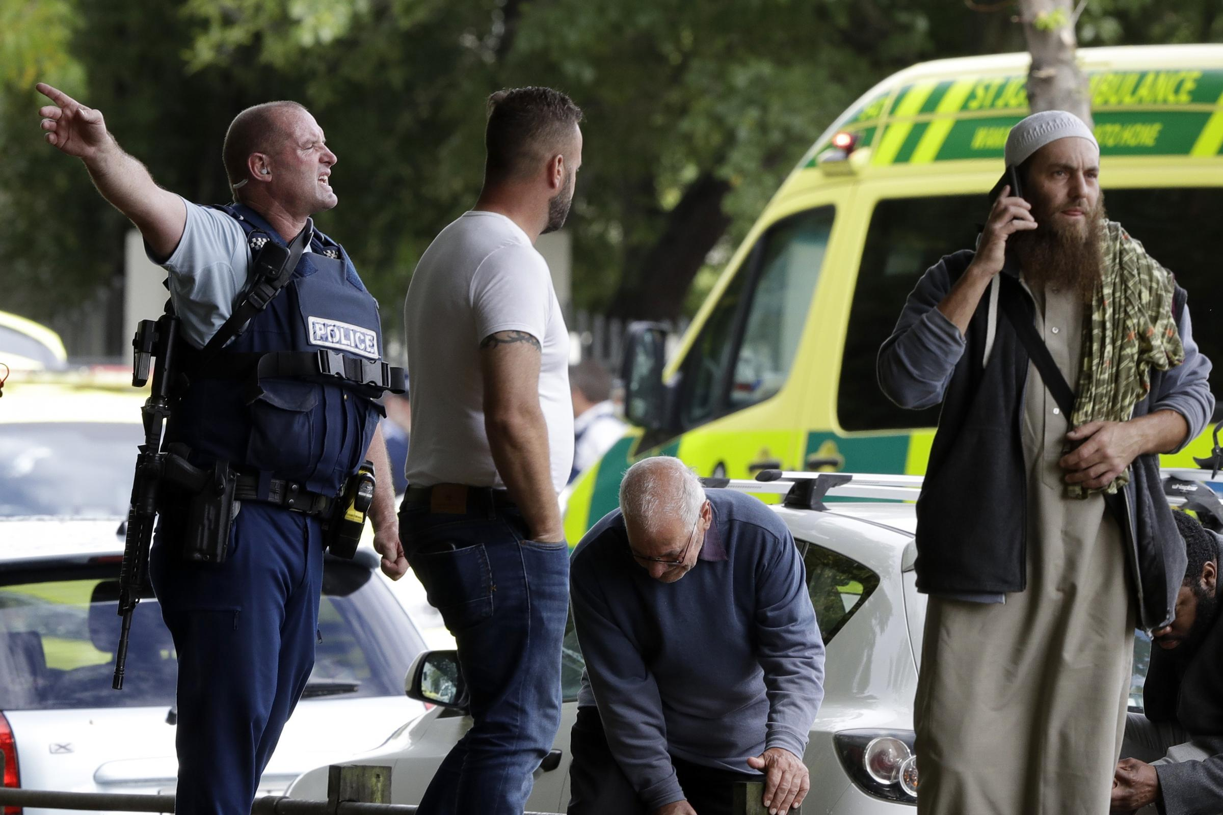 Police attempt to clear people from outside a mosque in central Christchurch