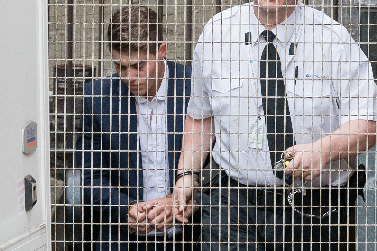 Alex Hepburn (left) is led out of Hereford Crown Court after being jailed for five years for raping a woman he found