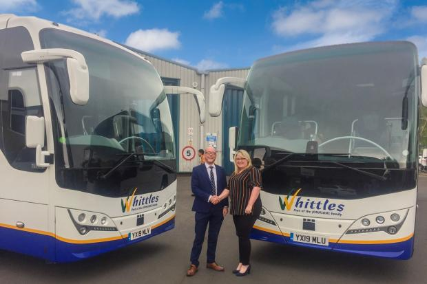 Dee Jackson, Whittles general manager, with Simon Wood of ADL on hand over day. Picture: Whittles Coaches
